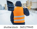 Man With Snow Shovel Near...