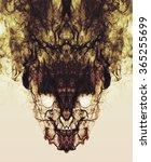 Small photo of Psychedelic smoke reflections form a creepy symmetrical skull face. A dark, burning, smokey, freaky demon.