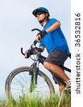 young bicyclist in a blue... | Shutterstock . vector #36532816