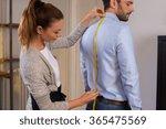 tailor standing near male... | Shutterstock . vector #365475569