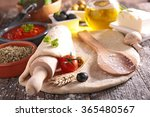 raw dough pizza and ingredient | Shutterstock . vector #365480567
