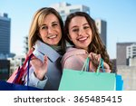 mother and daughter smiling at... | Shutterstock . vector #365485415