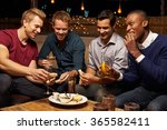 group of male friends enjoying... | Shutterstock . vector #365582411