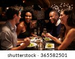two couples enjoying meal in... | Shutterstock . vector #365582501
