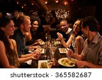 group of friends enjoying meal... | Shutterstock . vector #365582687