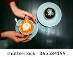 cup of cappuccino in hands | Shutterstock . vector #365584199