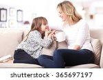 portrait of a beautiful mother... | Shutterstock . vector #365697197