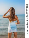 young woman in white dress  on... | Shutterstock . vector #365777189