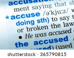 Small photo of Close-up of word in English dictionary. Accuse, definition and transcription
