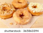 donuts on wooden background | Shutterstock . vector #365863394
