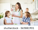 mother and children with carafe ... | Shutterstock . vector #365881901