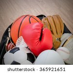 Small photo of sports equipment in a holdall sports bag on a gym floor. football, rugby, baseball, cricket, basketball, boxing, badminton, squash.