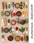 Small photo of Spice and herb food seasoning sampler over natural hemp paper background.