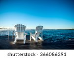 Muskoka Chairs On A Dock At A...