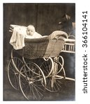 Cute Baby In Vintage Buggy....