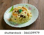 Small photo of Sweet couscous Bil Zbib.Algerian dessert with berries and fruits