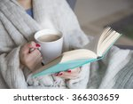 Woman With A Book And Cup Of...