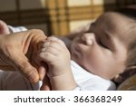 baby is holding  hand  | Shutterstock . vector #366368249