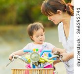 mother try to ride a bicycle... | Shutterstock . vector #366392741