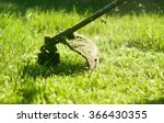 mowing a lawn with a lawn mower | Shutterstock . vector #366430355