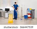 Full Length Of Male Janitor...
