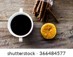 black coffee on wood background  | Shutterstock . vector #366484577
