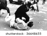 Small photo of LONDON-MARCH 31: A British police officer grapples with a protester during the Poll Tax Riots on March 31, 1990 in Trafalgar Square, London.
