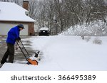 Man Clearing His Driveway With...