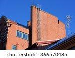 A Tall Ladder Leads Up A Flat...