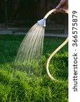 watering the grass | Shutterstock . vector #366575879