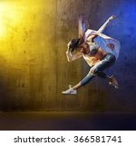 young hip hop dancer jumping | Shutterstock . vector #366581741