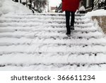 Woman Climbs The Stairs In The...