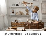 little boy sits on a suitcase... | Shutterstock . vector #366658931