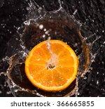 Orange In Water Splashes On A...