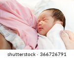 Asian Mother With Newborn Baby...