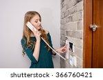 woman talking on the intercom... | Shutterstock . vector #366760421