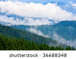 landscape with mountain rides covered fog after rain - stock photo