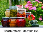 Jars Of Pickled Vegetables And...