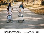 young mother walking with her... | Shutterstock . vector #366909101