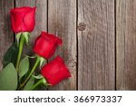 Red Roses Over Wooden Table....