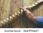 a male hand stopping the domino ... | Shutterstock . vector #366994667