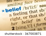 Small photo of Close-up of word in English dictionary. Belief, definition and transcription