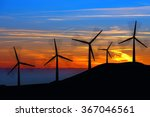 Silhouettes Of Wind Turbines A...
