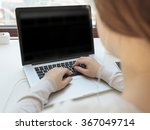 young woman working on laptop    | Shutterstock . vector #367049714