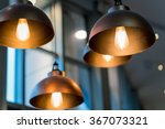 A Group Of Hanging Lights With...