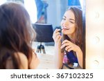 young woman applying lipstick... | Shutterstock . vector #367102325