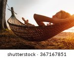 Lady Relaxing In The Hammock O...