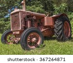An Old Tractor In A Field On A...