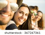 friends sitting at the beach... | Shutterstock . vector #367267361