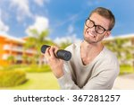 funny weak man tries to lift a... | Shutterstock . vector #367281257
